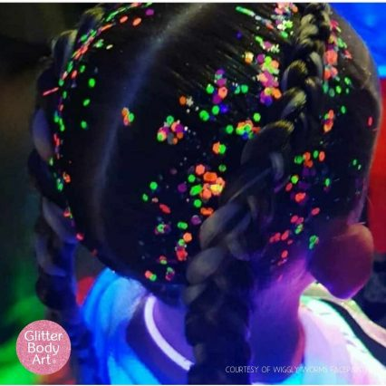 little girl with neon glitter in her hair