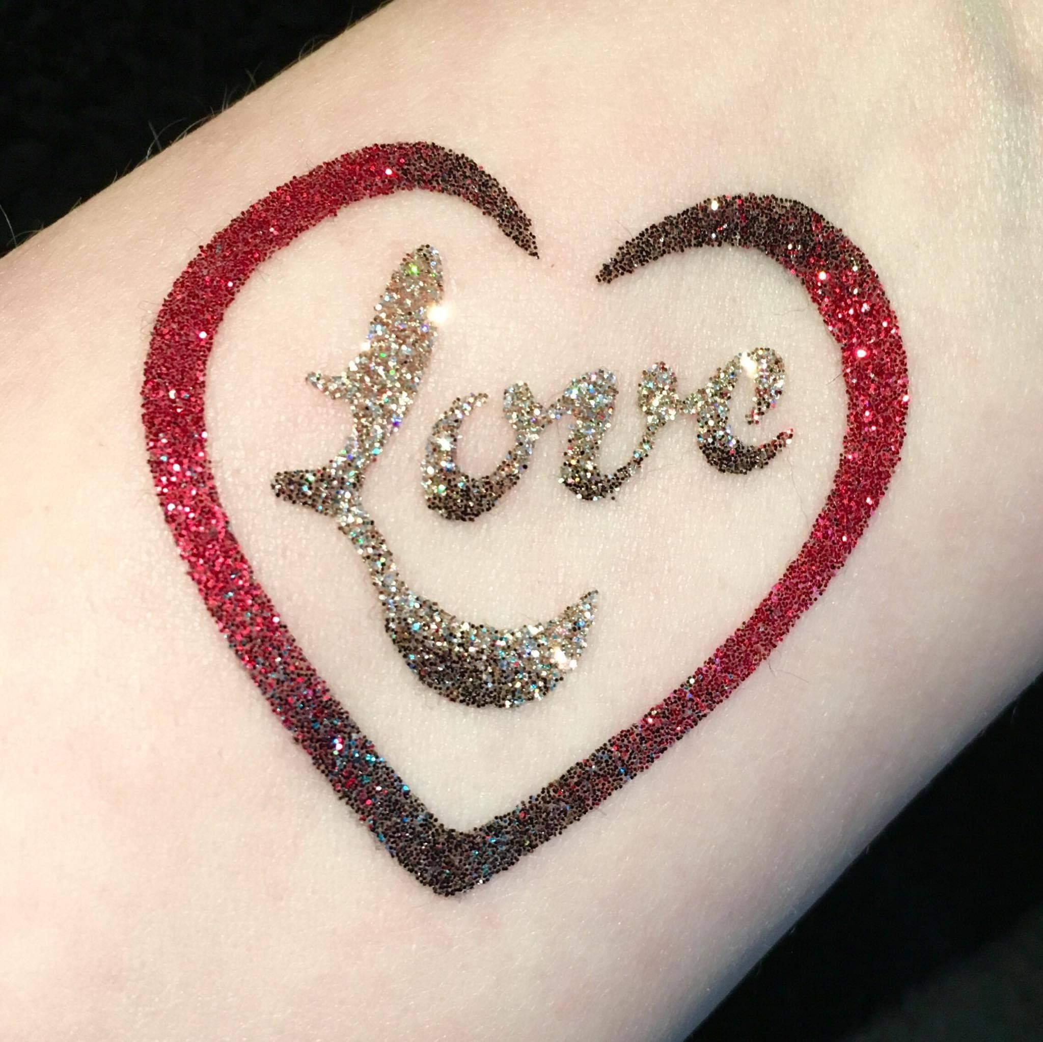 love heart temporary tattoo with love wordart written inside it