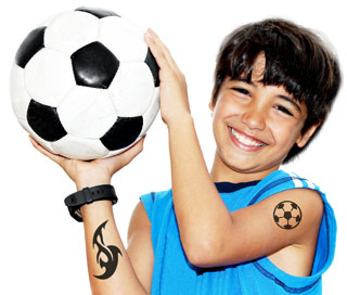 young boy with fake temporary tattoo made from black body paint